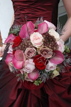 pink and red bouquet against a red dress