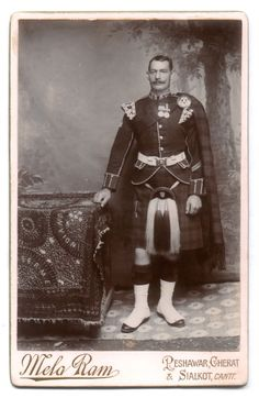:::::::::::: Antique Photograph :::::::::::: Incredible photograph of a man wearing a kilted uniform displaying a four clasped Queen's South Africa Medal and the double clasped Kings South Africa Medal for his service in the Boer War. 1902