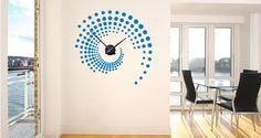 Different size dots aligned in a swirl shape creates this modern looking design. Combine with a sleek and silent clock mechanism and you'll have our Swirl Around the clock wall sticker. This premium product is manufactured in the USA and completely removable. Starts at $75.