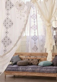 Light moroccan style drapes over windows