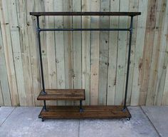 Industrial garment stand. Recycled wood and gas pipe.