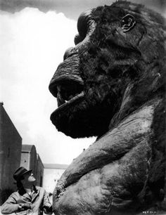 Producer Merriam C. Cooper checking out his Brainchild from 1933's KING KONG. This Full-Size head was used for all the Close-Ups and when he was chewing on the natives. The mouth closed and opened along with the eyes.