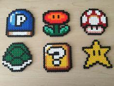 Super Mario items hama perler beads by BeadsByGeeks Perler Beads Mario, Mario Hama, Diy Perler Beads, Perler Bead Art, Pearler Beads, Fuse Beads, Melty Bead Patterns, Pearler Bead Patterns, Perler Patterns