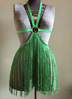 A gorgeous green elastic and 14 fringe halter frame bra perfect for burlesque. Shimmy it up with the lovely an unique piece with gold tone
