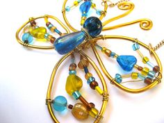 Butterfly suncatcher wire wrapped ornament by SunshineDaydreamz