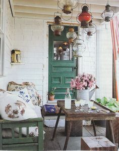 "vintagecottagefrench: "" I love the boutquet of pink flowers in an old metal watering can. And the beautifully painted green door. And the hanging lanterns and the pillows. Ideas for my sun porch. Outdoor Rooms, Outdoor Living, Outdoor Kitchens, Boho Home, Bohemian Porch, Interior Exterior, Interior Design, Porch Decorating, Living Spaces"