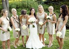I like the bridesmaids in this pic, not the color... But how they all have different style dresses and completely different jewelery but still make the picture look cohesive. I hate the idea of different style dresses, but this helps to open my mind.