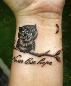 Cute Owl And Inspirational Quote Tattoo On Wrist