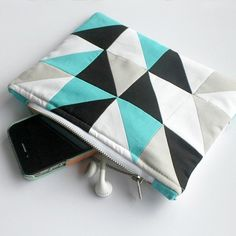 Get out your sewing machine and stitch up this modern little zipper pouch. Quick, easy with so many uses!