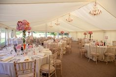 Tall table arrangements and flat white linings make for a stunning, elegant marquee.