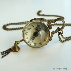 Bronze Dangle Magnifying Glass Watch Necklace - I actually bought one of these from a vendor at Imagicon!  I absolutely love it.