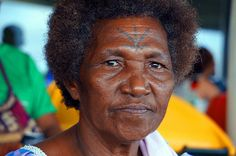 A woman from the Manus Province of Papua New Guinea. Many Manus Islanders have tattoos on their foreheads depicting a bird footprint on the sand.  www.papuanewguinea.travel/manus