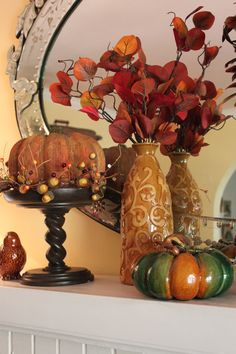 I like the idea of raising the pumpkin with a candlestick (I think this is the Southern Living at Home Barley Twist Pedestal)