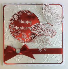 Tattered Lace Cascading Circle die as is the butterfly. Tonic Roseanne embossing folder.