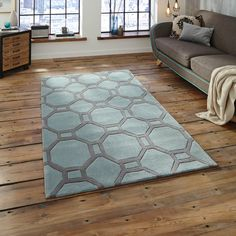 The contemporary Geometric design in Blue and Grey is sure to be a focal point in any room of your home.