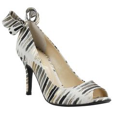 Make a statement with the Ellasee in cream & gold! #gold #white #black #bow #heels #wedges #pumps #fashion #summerstyle