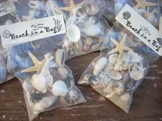 BEaCH iN A BaG SeA SHeLLS $1.00, via Etsy. These would be awesome for a destination wedding or beach themed wedding!