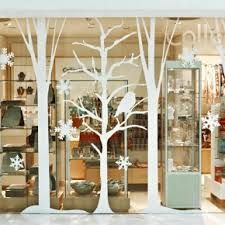 Paper silhouette tree cut-outs window display