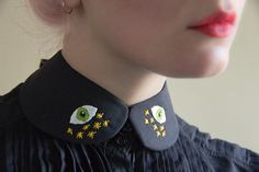 Embroidered collar - or shirt with huge eyes embroidered in an asymmetrical pattern on it - pleasantly creepy!