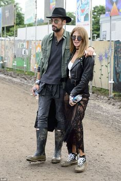 stylish the pair appeared in high spirits as the made their way around the muddy festival ground and were happy to pose for pictures