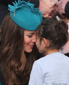 A beautiful photo of the Duchess getting the traditional welcome from a very sweet little girl.