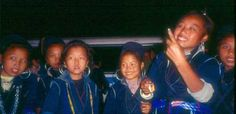 I wonder what happened to these girls. I made this photo somewhere in a village on a day trek in 1994 near Sapa, Vietnam. These are Hmong girls.http://www.bicycle-adventures.com/sapa-and-lao-cai.html