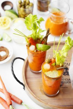 Made with carrot juice, these Carrot Bloody Marys are the perfect cocktail for your Easter or Springtime brunch! Flavored with all the classic ingredients! Bloody Mary Mix, Healthy Cocktails, Onion Relish, Old Bay Seasoning, Pickled Onions, Lime Wedge, Baby Carrots, Worcestershire Sauce, Lime Juice