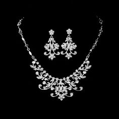 Silver plated ribbons curl throughout this floral jewelry set, featuring sparkling rhinestones and clear Swarovskibicone beads set in a modern design. Description from ebay.com. I searched for this on bing.com/images