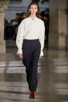 18. Blouse and large sleeve shirt in cotton oxford, suit pants in high density wool gabardine, clogs in leather
