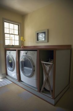 Another example of building storage around the #washer and #dryer. This example creates great counter space for convenient folding and storage for a hamper.