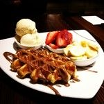 Sugar Waffle drizzled with warm liquid chocolate captured by @tianpeiyi