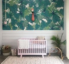 Love this palm leaf wallpaper and shiplap wall in the nursery!