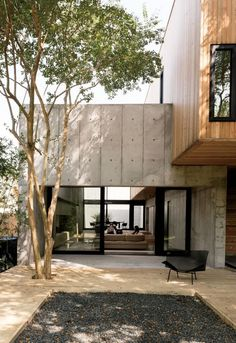 Concrete Box House by Robertson Design - Houston, Texas Couple Builds Modern Concrete House Sliding doors from Western Window Systems connect the living room and the deck, which is made of pressure-treated pine planks surrounding a black gravel pit. House Architecture Styles, Concrete Architecture, Residential Architecture, Interior Architecture, Architecture Unique, Modern Japanese Architecture, Japanese Modern Interior, Japanese Modern House, Japanese Minimalism