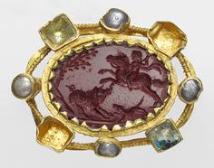 Roman intaglio made of jasper, gold mount set with pearls and glass, mid 2nd-early 3rd c. AD
