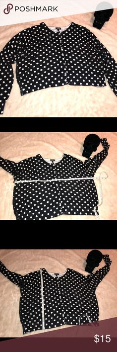 Torrid black and white dot sweater cardigan 2x Black and white/off white sweater/cardigan from Torrid cute rhinestone/bling buttons. There is a slight imperfection in the thread on the one sleeve and there is pilling on this item as shown in photos but nothing a sweater depillar couldn't fix . All items come from smoke free home. 🐺Husky friendly environment. All items are kept in plastic containers, but shed happens 😊 torrid Sweaters