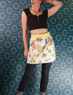 Check out this item in my Etsy shop https://www.etsy.com/ca/listing/537791527/60s-half-apron-white-yellow-floral-print