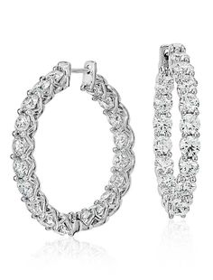 These diamond hoop earrings showcase 6 carats of brilliant Blue Nile Signature Ideal cut round diamonds set in enduring Platinum, an extraordinary gift appropriate for every occasion!