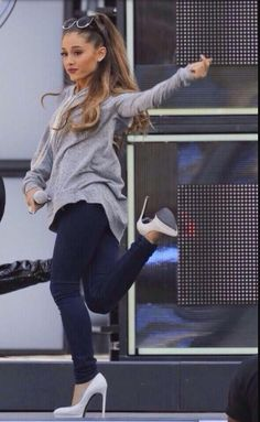 Q: How can she dance in those shoes? I can't even walk in them. A: She's Ariana Grande