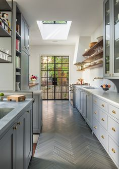 cabinet color: Benjamin Moore's Deep Silver which is a gorgeous choice. Ann Sacks floor tile