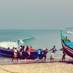 The fishermen help haul in a boat after a night out in the ocean, whilst they pull it in they all sing in chorus as the beautiful left hander wave breaks in the distance. Edava Beach near Varkala, Kerala India in March 2014. #fishermen #ocean #india #sing #kerala #travel #travelphotography #throwback2years #anzacandpeggy #waves #secretspot #surfingindia #worldframeclub