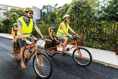 Jonathan Purtle and Sara Hirschler make themselves more visible to drivers with orange bicycles and yellow reflective gear. Photography by Linette Kielinski Child Bike Seat, South Philly, Commute To Work, Cargo Bike, Orange, Yellow, Bicycles, Car Seats, Photography