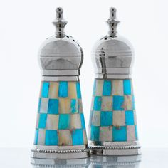 Add character to your tabletop setup with these beautiful artisan Turquoise Lafayette Salt and Pepper Shakers . Crafted of sturdy and durable nickel-plated brass coupled with turquoise and cream mother of pearl paneling, these shakers feature crown like tops.