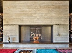A large two-sided board-formed concrete fireplace with custom enclosure doors separates the main living and dining space from a more intimate media room. Fireplace Doors, Concrete Fireplace, Whistler, Jackson Hole Skiing, Board Formed Concrete, Ski Rental, Mountain Homes, Mountain Biking, Global Design