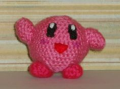 Handmade amigurumi doll based off the character Kirby from the game Kirby.