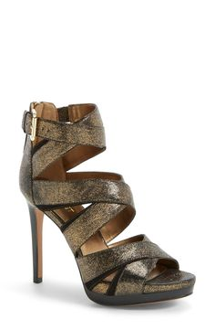 The bronze metallic crisscrossed straps make this flirty platform sandal just right for a night out.