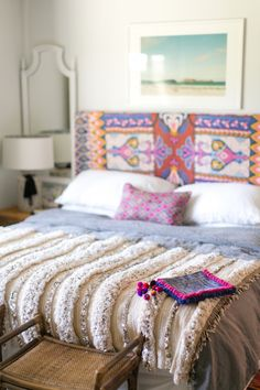Could use the blankets I have from Bolivia to make a colorful headboard. Amber Interiors