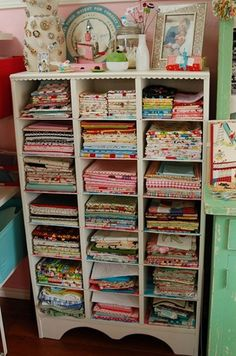 Love this idea for fabric storage.  Could also use this for scrapbook paper, bins w misc. craft items, etc.