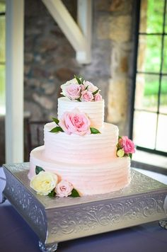 Ombré wedding cake idea - three-tiered, buttercream-frosted wedding cake with pink ombré frosting and fresh flowers {Rachel Pearlman Photography}