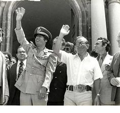 Muammar Gaddafi and Prime Minister Mintoff waving to the crowd at the main entrance to the Auberge de Castille on the day Britain's lease on its military base in Malta expired, 31 March 1979