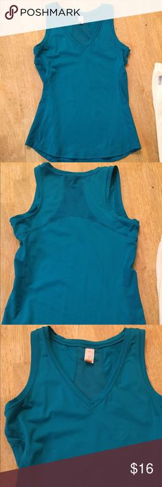 Lucy workout tank Lucy workout tank in teal. Pic looks blue but it is a true teal. Size medium. Molded interior cups. EUC. no flaws Lucy Tops